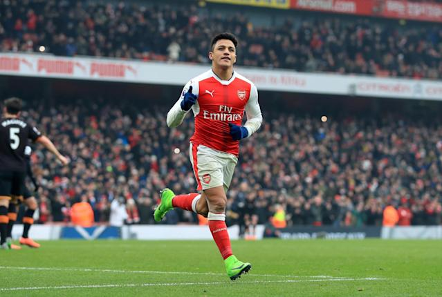 <p>Alexis Sanchez celebrates netting Arsenal's second goal from the penalty spot</p>