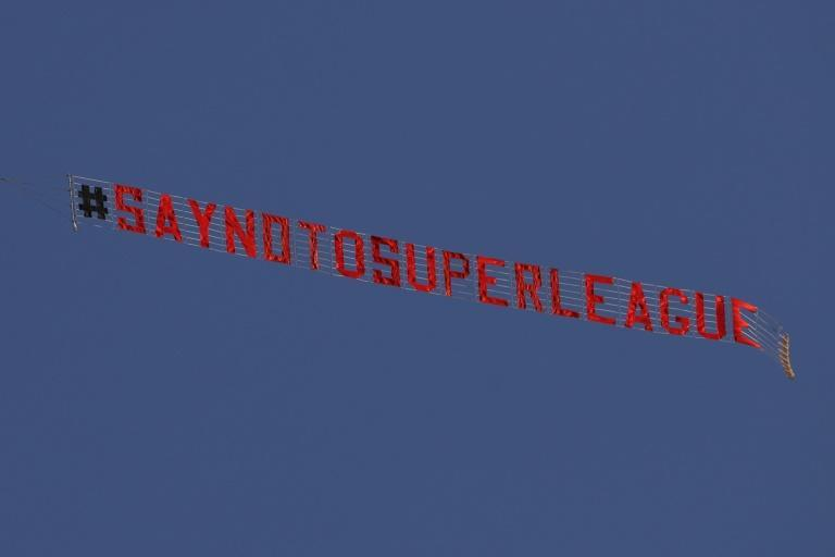 A plane flies above Elland Road in Leeds before the Premier League game against Liverpool protesting against the planned Super League