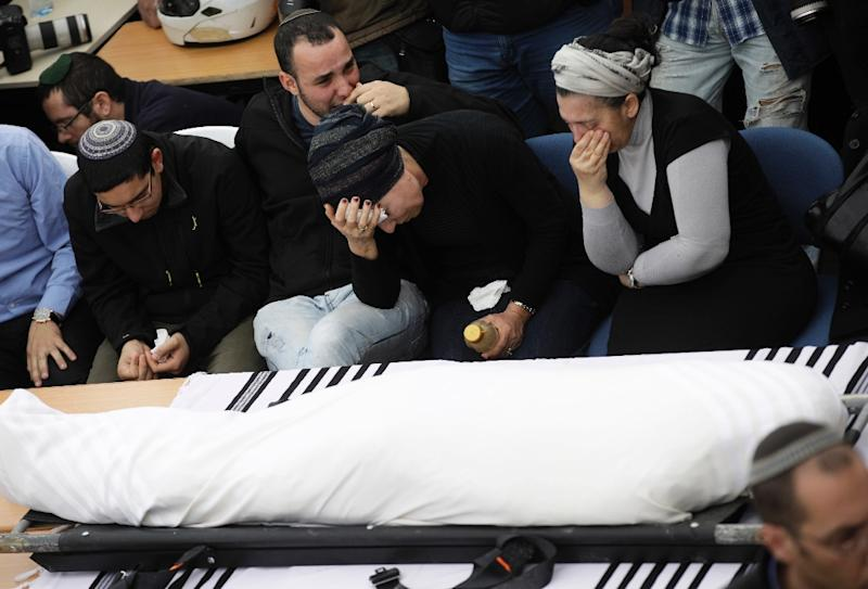 Relatives of Itamar Ben Gal mourn during the rabbi's funeral in the West Bank settlement of Har Bracha on February 6, 2018 (AFP Photo/JIM HOLLANDER)