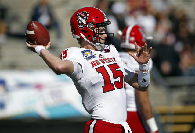 North Carolina State quarterback Ryan Finley throws during the warmups before the start of the Sun Bowl NCAA college football game against Arizona State in El Paso, Texas, Friday, Dec. 29, 2017. (AP Photo/Andres Leighton)