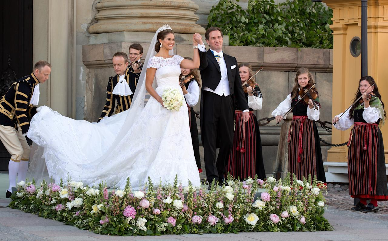 <p>On June 8, 2013 Princess Madeleine of Sweden and Christopher O'Neill wed in Stockholm. For the ceremony, Madeleine donned a sweeping organza gown by Valentino finished with a dazzling tiara and veil. The couple's lavish day included a towering pyramid 'cake' made up of 700 macarons.<br />It is interesting to note, that the couple also eschewed tradition and kept their original surnames. The wedding was paid for by Princess Madeleine's father, King Carl XVI Gustaf, and is estimated to have cost £258,450.00. <em>[Photo: Getty]</em><br /></p>