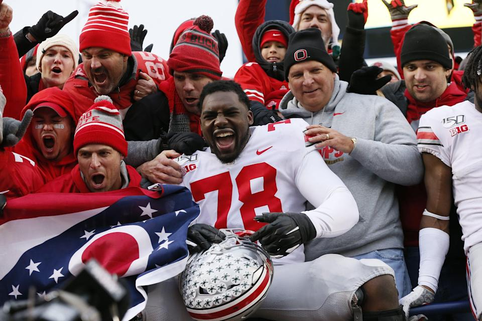 Ohio State tackle Nicholas Petit-Frere, here celebrating with fans after a win over Michigan in 2019, will serve as a public spokesman for a Tampa technology startup. Credit: USA TODAY Sports