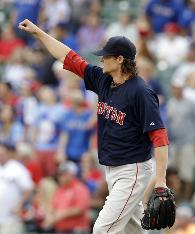 Boston Red Sox's Clay Buchholz celebrates as center fielder Jackie Bradley Jr. makes a leaping grab on a fly out by Texas Rangers' Prince Fielder that saved a potential home run in the first inning of a baseball game, Friday, May 9, 2014, in Arlington, Texas. (AP Photo/Tony Gutierrez)