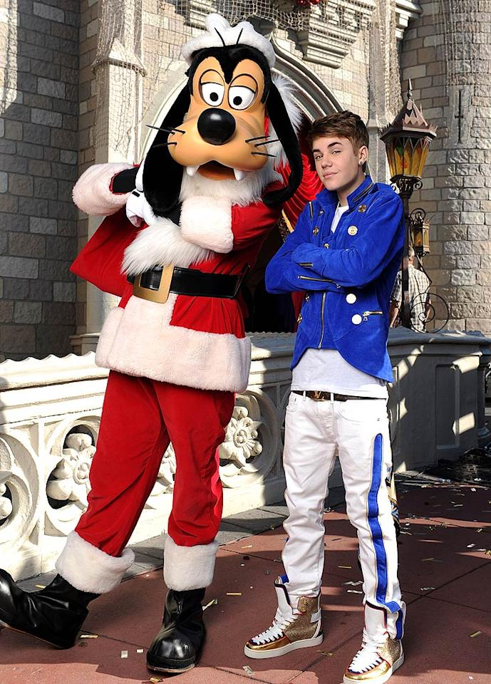 "Justin Bieber got a little ""goofy"" with none other than Goofy -- dressed as Santa -- over the weekend when he taped a performance segment for the ""Disney Parks Christmas Day Parade"" TV special at Florida's Magic Kingdom. Between that, his performance at the lighting of the Rockefeller Christmas tree, and his ""All I Want for Christmas Is You"" video with Mariah Carey, the Biebs is clearly in the holiday spirit this year! (12/3/2011)"