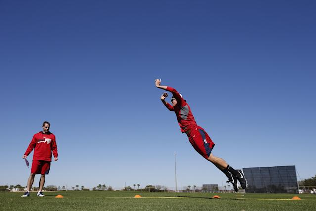 Washington Nationals relief pitcher Tyler Clippard, right, performs a standing long jump test during a spring training baseball workout, Friday, Feb. 14, 2014, in Viera, Fla. (AP Photo/Alex Brandon)