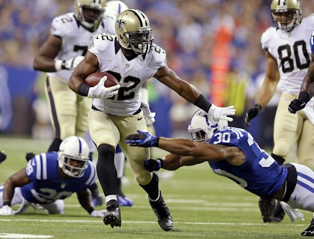 New Orleans Saints running back Mark Ingram breaks the tackle of Indianapolis Colts strong safety LaRon Landry (30) during the first half of an NFL preseason football game in Indianapolis, Saturday, Aug. 23, 2014. (AP Photo/Michael Conroy)