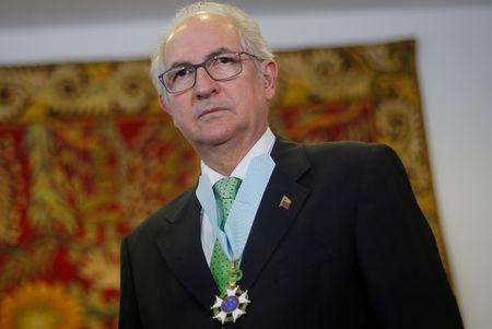 FILE PHOTO: Venezuelan exiled veteran opposition figure and former mayor of Caracas Antonio Ledezma wears an Order Medal Of Cruzeiro Do Sul after receiving it form Brazil's Foreign Minister Aloysio Nunes Ferreira (not pictured), at the Itamaraty Palace in Brasilia, Brazil April 27, 2018. REUTERS/Adriano Machado/File Photo