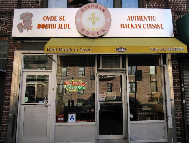 """This March 9, 2013 photo shows one of many ethnic restaurants in Astoria, in the New York City borough of Queens. """"Best Burek in Town"""" reads the canopy of the Djerdan Burek restaurant and bakery, which serves food from the Balkan region, including bureks, which are coils of yeasty, flaky dough filled with ground beef, spinach or cheese. Astoria and the adjacent neighborhood of Long Island City have much to offer tourists, from moderately priced hotels to museums, waterfront parksand lots of ethnic food. (AP Photo/Beth J. Harpaz)"""