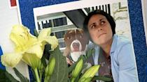 PHOTO: A photo of Katie Janness and her dog Bowie is displayed as part of a memorial in Piedmont Park in Atlanta, Ga., July 30, 2021. (WSB-TV)