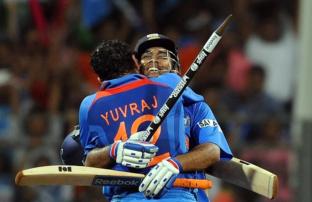 India cricketer Yuvraj Singh and captain Mahendra Singh Dhoni (R) celebrate their victory in the ICC Cricket world Cup final match between India and Sri Lanka at The Wankhede Stadium in Mumbai on April 2, 2011. India defeated Sri Lanka by six wickets to win the 2011 World Cup. AFP PHOTO / Prakash SINGH (Photo credit should read PRAKASH SINGH/AFP/Getty Images)