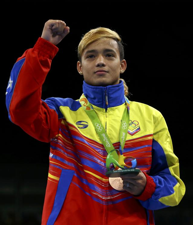 2016 Rio Olympics - Boxing - Victory Ceremony - Men's Fly (52kg) Victory Ceremony - Riocentro - Pavilion 6 - Rio de Janeiro, Brazil - 21/08/2016. Bronze medallist Yoel Finol (VEN) of Venezuela poses with his medal. REUTERS/Peter Cziborra FOR EDITORIAL USE ONLY. NOT FOR SALE FOR MARKETING OR ADVERTISING CAMPAIGNS.