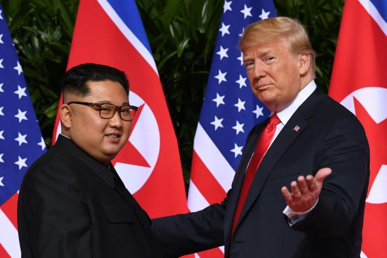US President Donald Trump meets North Korea's leader Kim Jong Un at the start of their historic June 2018 summit in Singapore (AFP Photo/SAUL LOEB)