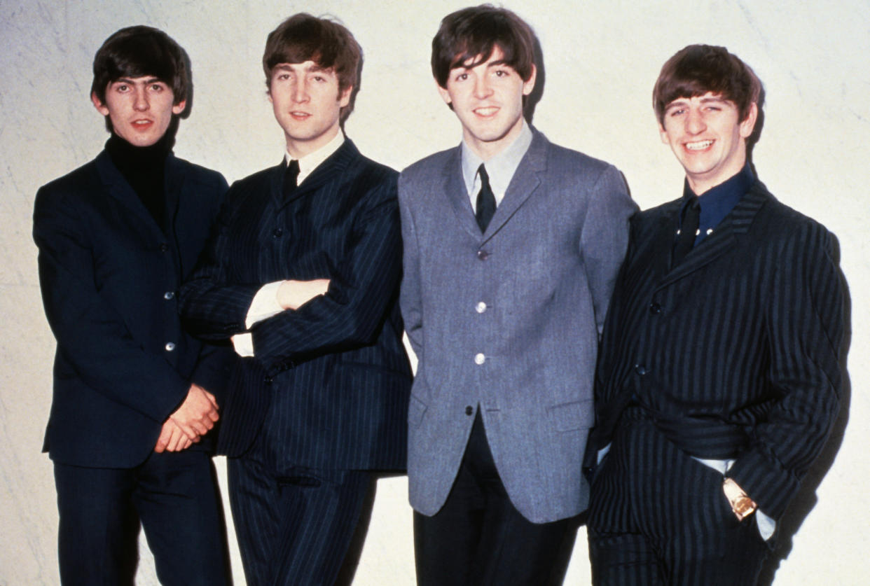 The Beatles posing together. From left to right: musicians George Harrison, John Lennon, Paul McCartney and Ringo Starr, circa 1965.