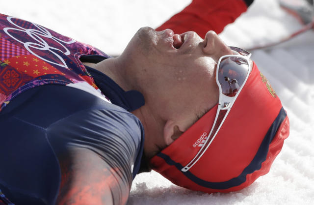 Russia's Alexander Legkov catches his breath after winning the gold during the men's 50K cross-country race at the 2014 Winter Olympics, Sunday, Feb. 23, 2014, in Krasnaya Polyana, Russia. (AP Photo/Matthias Schrader)