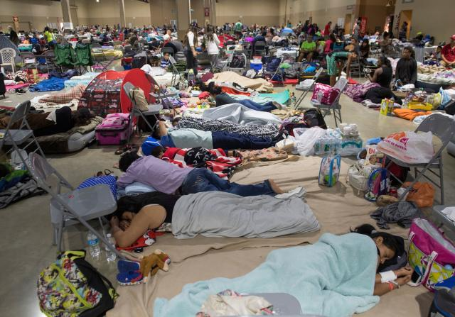<p>Hundreds of people gather in an emergency shelter at the Miami-Dade County Fair Expo Center in Miami, Fla., Sept. 8, 2017, ahead of Hurricane Irma. (Photo: Saul LoebAFP/Getty Images) </p>