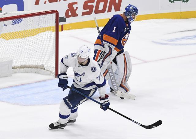 Tampa Bay Lightning's Victor Hedman (77) skates after he scored past New York Islanders goaltender Thomas Greiss (1) during the shootout in an NHL hockey game Friday, Feb. 1, 2019, in Uniondale, N.Y. The Lightning won 1-0. (AP Photo/Kathleen Malone-Van Dyke)