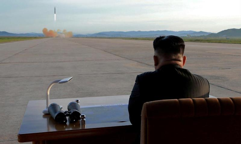 North Korean leader Kim Jong-un watches the launch of a Hwasong-12 missile in an undated photo released by the Korean Central News Agency in September.