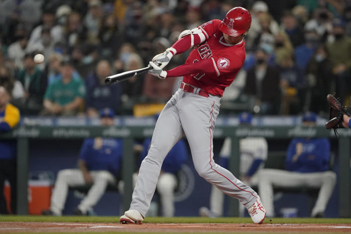 Los Angeles Angels' Shohei Ohtani hits a solo home run during the first inning of a baseball game against the Seattle Mariners, Sunday, Oct. 3, 2021, in Seattle. (AP Photo/Ted S. Warren)