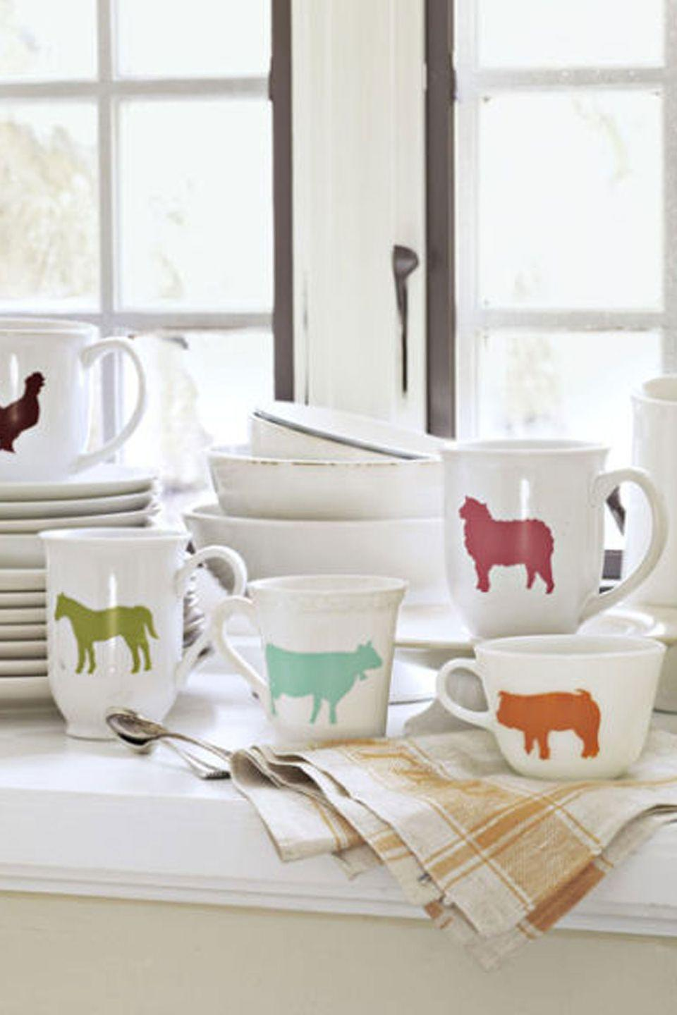 """<p>Look no further than the nearest pasture for inspiration to dress up plain dishware. To duplicate these mugs, print and cut out <a href=""""https://www.amazon.com/Fun-Farm-Animals-Stencils-Dover/dp/0486257592/?tag=syn-yahoo-20&ascsubtag=%5Bartid%7C10050.g.645%5Bsrc%7Cyahoo-us"""" rel=""""nofollow noopener"""" target=""""_blank"""" data-ylk=""""slk:animal shapes"""" class=""""link rapid-noclick-resp"""">animal shapes</a>. Place each shape atop a small piece of <a href=""""https://www.amazon.com/Tact-Covering-Self-Adhesive-Privacy-18-Inches/dp/B00D8GBO2G?tag=syn-yahoo-20&ascsubtag=%5Bartid%7C10050.g.645%5Bsrc%7Cyahoo-us"""" rel=""""nofollow noopener"""" target=""""_blank"""" data-ylk=""""slk:contact paper"""" class=""""link rapid-noclick-resp"""">contact paper</a> and outline it in pencil. Cut out with a <a href=""""https://www.amazon.com/X-ACTO-Craft-Tools-Knife-Safety/dp/B001KZH26Y?tag=syn-yahoo-20&ascsubtag=%5Bartid%7C10050.g.645%5Bsrc%7Cyahoo-us"""" rel=""""nofollow noopener"""" target=""""_blank"""" data-ylk=""""slk:craft knife"""" class=""""link rapid-noclick-resp"""">craft knife</a>; then discard the paper inside the outline. Peel away the backing and affix the stencil to a <a href=""""https://www.target.com/p/porcelain-coffee-mug-white-threshold-153/-/A-13891751"""" rel=""""nofollow noopener"""" target=""""_blank"""" data-ylk=""""slk:clean, dry mug"""" class=""""link rapid-noclick-resp"""">clean, dry mug</a>, making sure to center the image. Following the package directions, use a soft brush to fill in the outline with dishwasher-safe <a href=""""https://www.amazon.com/s/ref=nb_sb_noss?url=search-alias%3Darts-crafts&field-keywords=PermEnamel+paint&tag=syn-yahoo-20&ascsubtag=%5Bartid%7C10050.g.645%5Bsrc%7Cyahoo-us"""" rel=""""nofollow noopener"""" target=""""_blank"""" data-ylk=""""slk:PermEnamel paint"""" class=""""link rapid-noclick-resp"""">PermEnamel paint</a><em>;</em> let set for a few minutes. Carefully remove the contact paper, clean up any edges with a damp cotton swab, and allow the paint to cure for 10 days.<br></p><p><strong><a class=""""link rapid-noclick-resp"""" href=""""https://www.target.com/p/por"""