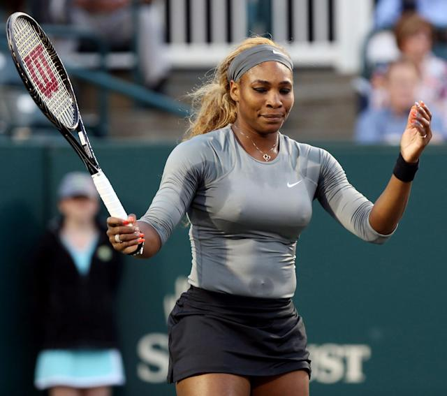 This photo made Tuesday, April 1, 2014 shows Serena Williams gesturing during a loss to Jana Cepelova at the Family Circle cup tennis tournament in Charleston, S.C. Cepelova defeated Williams, 6-4, 6-4. (AP Photo/The Post And Courier, Grace Beahm )