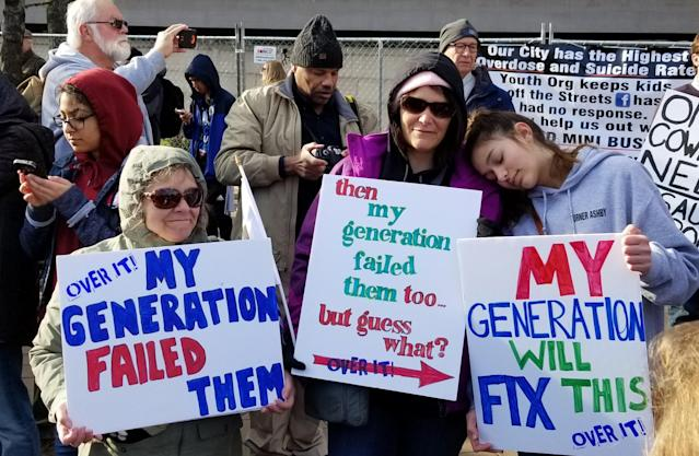 Family members Jan, Becky and Amy hold signs at the March for Our Lives in Washington, D.C. (Christopher Wilson/Yahoo News)