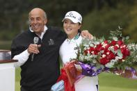 Jin Young Ko, right, of South Korea, is embraced by Tournament Golf Foundation president Tom Maletis, left, after she won the LPGA Cambia Portland Classic golf tournament in West Linn, Ore., Sunday, Sept. 19, 2021. (AP Photo/Steve Dipaola)
