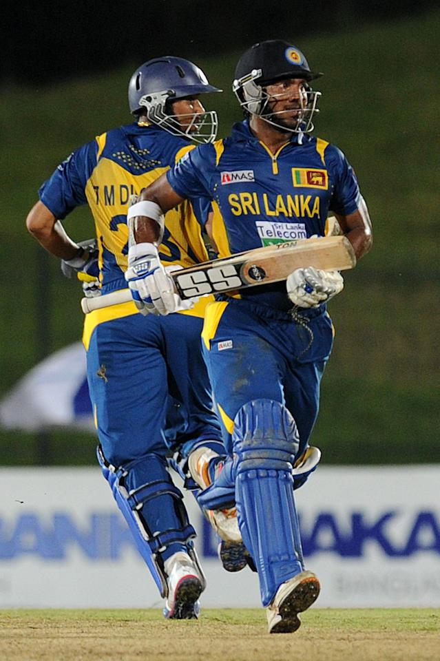 Sri Lankan cricketer Tillakaratne Dilshan (L) and Kumar Sangakkara runs between the wickets during the opening one-day international (ODI) match between Sri Lanka and Bangladesh at The Suriyawewa Mahinda Rajapakse International Cricket Stadium in the southern district of Hambantota on March 23, 2013.  Sri Lankan cricket captain Angelo Mathews  won the toss and elected to field. AFP PHOTO/ Ishara S. KODIKARA        (Photo credit should read Ishara S.KODIKARA/AFP/Getty Images)