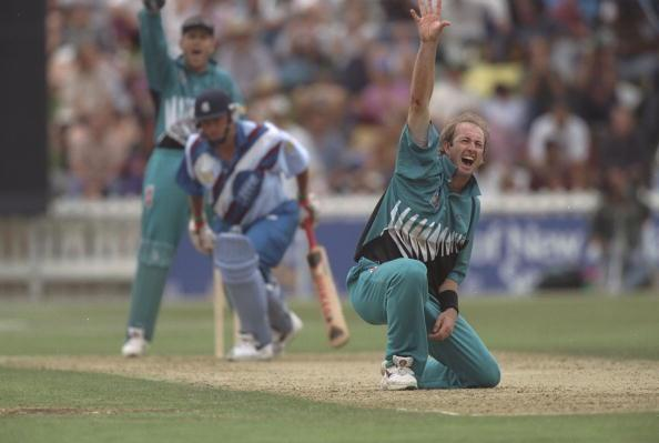 4 Mar 1997:  Chris Harris of New Zealand appeals to the umpire on one knee during the fifth one day international at Wellington, New Zealand. Mandatory Credit: Clive Mason /Allsport