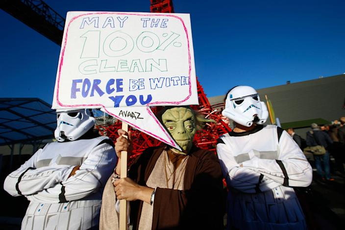 <p>Global citizen's movement Avaaz in a Star Wars themed stunt with Yoda and two storm-troopers pose during a protest for Paris climate agreement to put the world on course for clean energy front of the mini red Eiffel Tower replica during the COP21, United Nations Climate Change Conference in Le Bourget, north of Paris, France, Wednesday, Dec. 9, 2015. (AP Photo/Francois Mori) </p>
