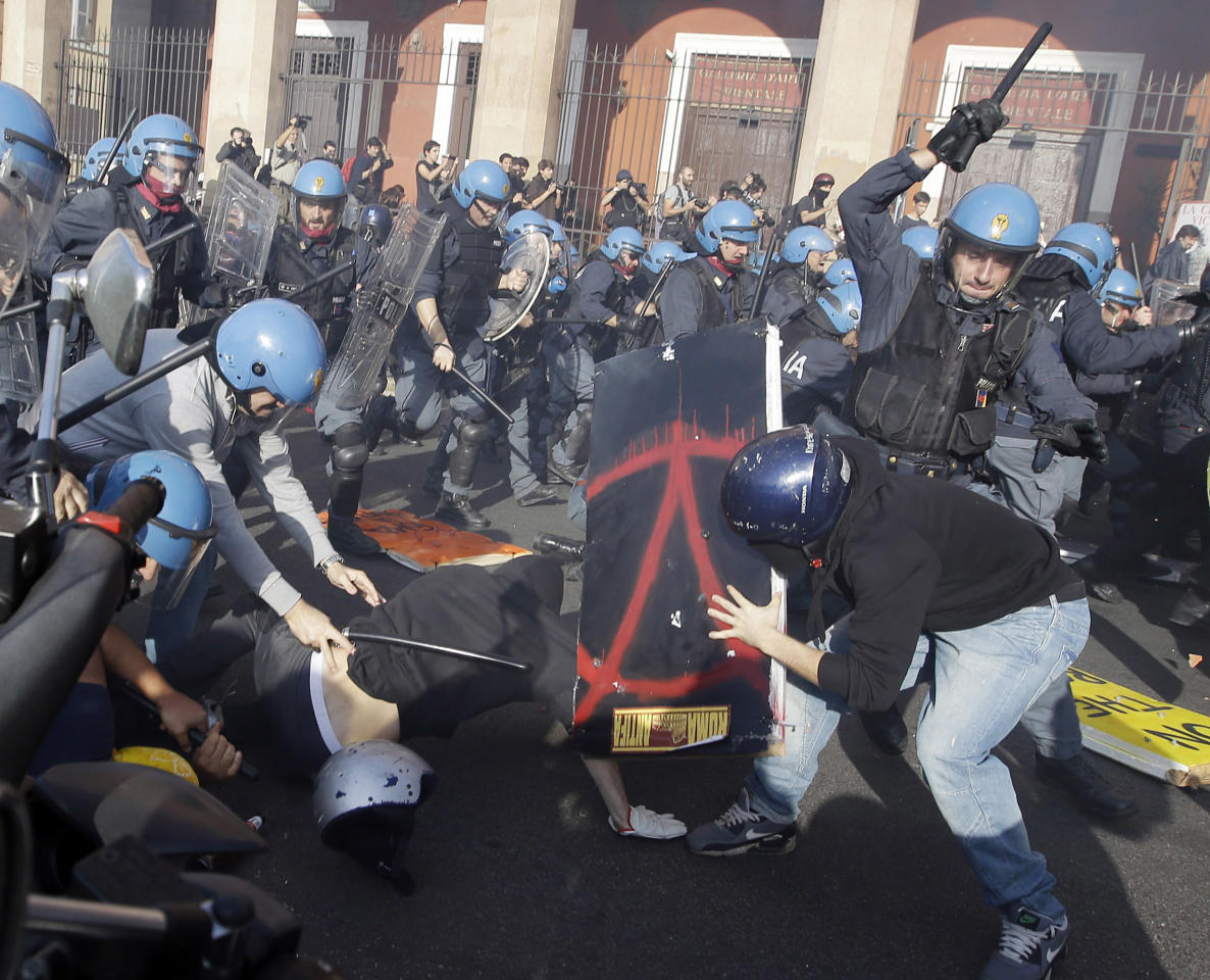 Police clash with demonstrators during a protest against Italian Government austerity measures in Rome, Wednesday, Nov. 14, 2012. Workers across the European Union sought to present a united front against rampant unemployment and government spending cuts Wednesday with a string of strikes and demonstrations across the region. Protesters clashed with police in various demonstrations in Rome, Milan, Turin, Padua and Brescia. (AP Photo/Gregorio Borgia)