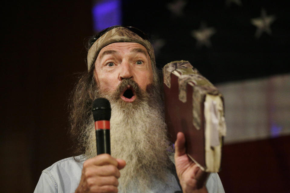"""Phil Robertson of """"Duck Dynasty"""" speaks at a rally for U.S. Senate hopeful Roy Moore, Monday, Sept. 25, 2017, in Fairhope, Ala. (AP Photo/Brynn Anderson)"""
