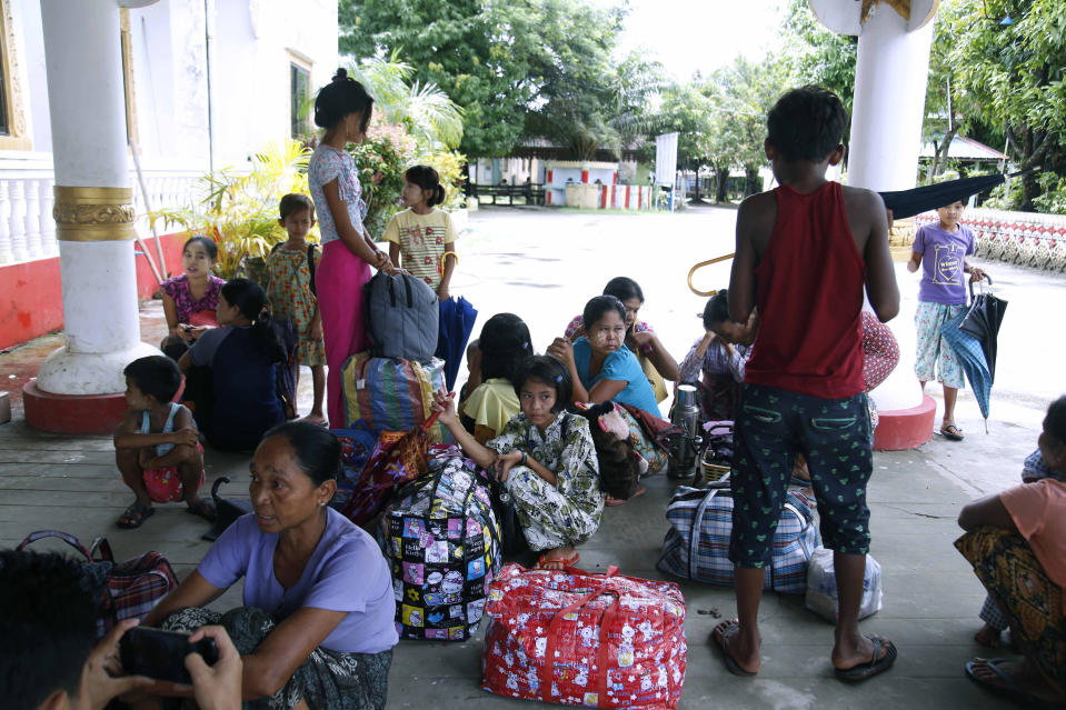 Ethnic Buddhist Rakhine villagers arrive at a temporary monastery camp with their belongings, Monday, June 29, 2020, in Sittwe, Rakhine State, Myanmar. Thousands of people in an area of western Myanmar where there have been clashes between the government and ethnic rebels have been fleeing from their villages after an evacuation order from officials, despite being revoked several days ago. (AP Photo)