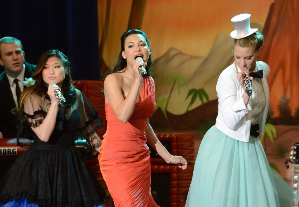 "Tina (Jenna Ushkowitz), Santana (Naya Rivera), and Brittany (Heather Morris) perform at their prom in the ""Prom-asaurus"" episode of ""<a target=""_blank"" href=""http://tv.yahoo.com/glee/show/44113"">Glee</a>."""