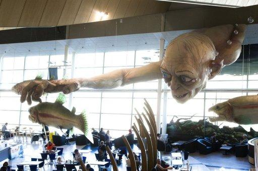 """A giant Gollum creature from """"The """"Hobbit"""" movie catches a fish on the ceiling of Wellington airport on October 31, 2012. The producers of """"The Hobbit"""" movies have rejected allegations from animal rights group PETA that animals have died during the making of the highly anticipated Tolkien trilogy in New Zealand"""