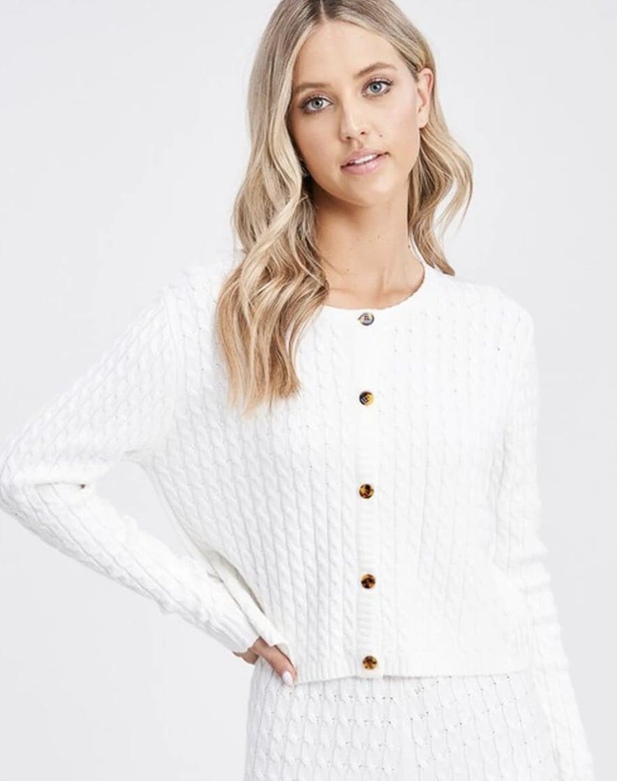 <p>This <span>Dana Scott Joy Cable Knit Cardigan</span> ($79) makes a serious case for wearing white after Labor Day.</p>