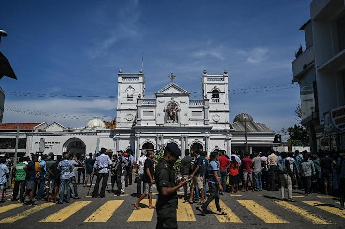 Local residents gather outside the St Anthony's Shrine in Colombo (AFP Photo/Mohd RASFAN)