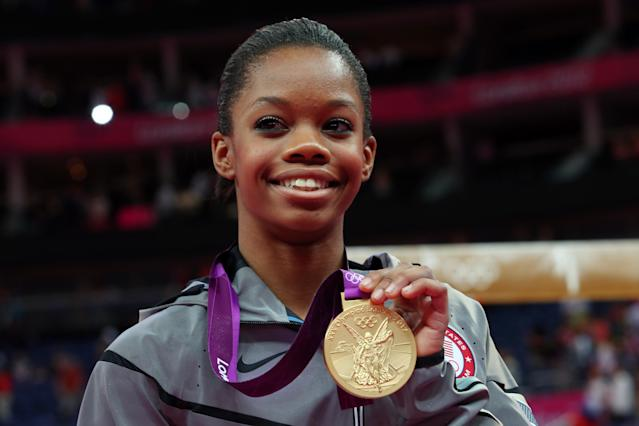 Gabrielle Douglas of the United States celebrates on the podium after winning the gold medal in the Artistic Gymnastics Women's Individual All-Around final on Day 6 of the London 2012 Olympic Games at North Greenwich Arena on August 2, 2012 in London, England. (Photo by Ronald Martinez/Getty Images)