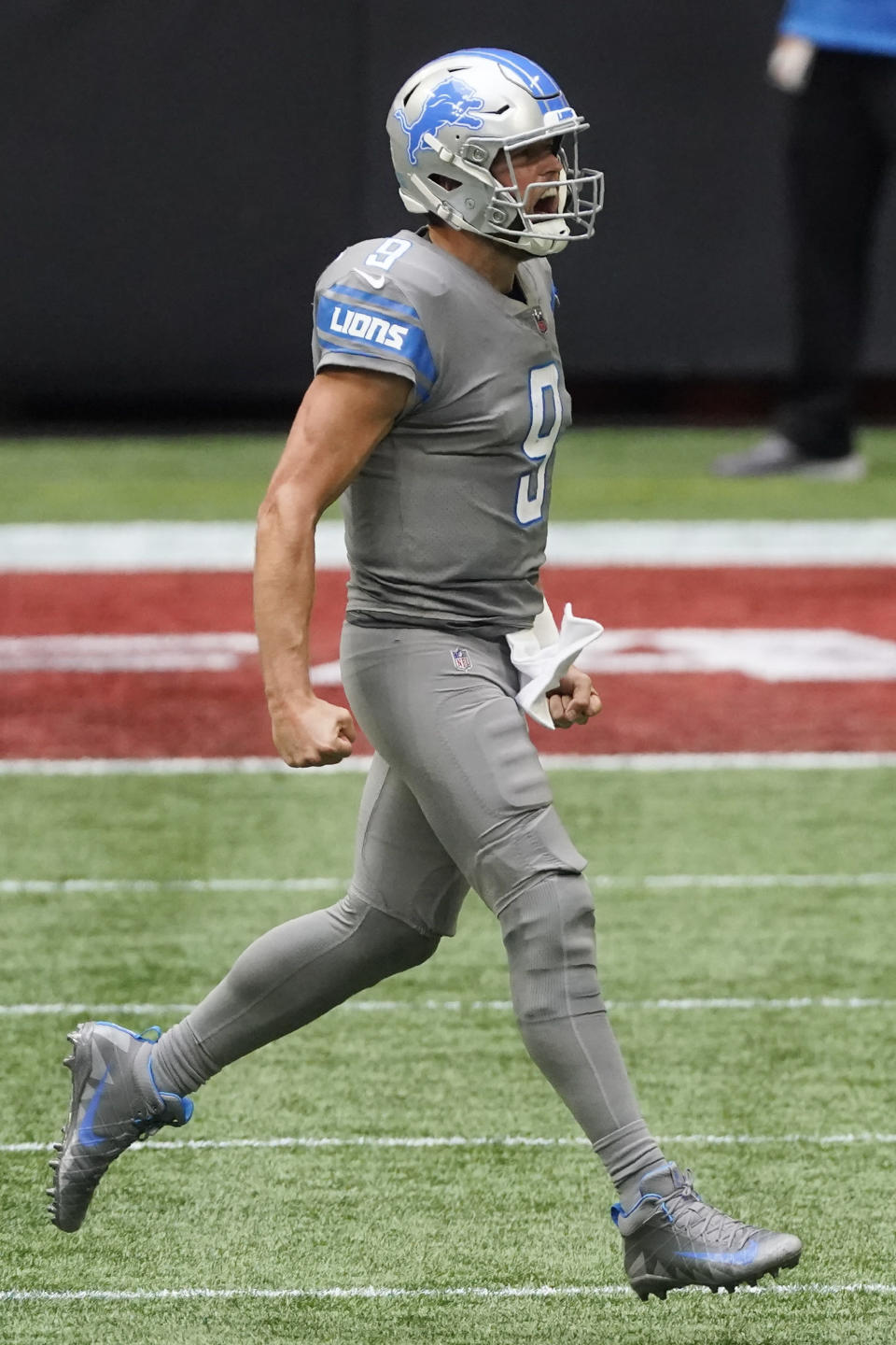 Detroit Lions quarterback Matthew Stafford (9) celebrates victory during the second half of an NFL football game against the Atlanta Falcons, Sunday, Oct. 25, 2020, in Atlanta. The Detroit Lions won 23-22. (AP Photo/John Bazemore)