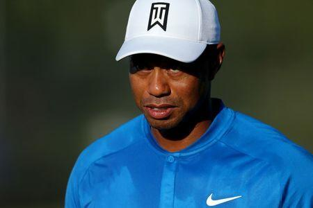 Jun 12, 2018; Southampton, NY, USA; Tiger Woods walks off the driving range before his practice round during Tuesday's practice round of the 118th U.S. Open golf tournament at Shinnecock Hills. Mandatory Credit: Brad Penner-USA TODAY Sports