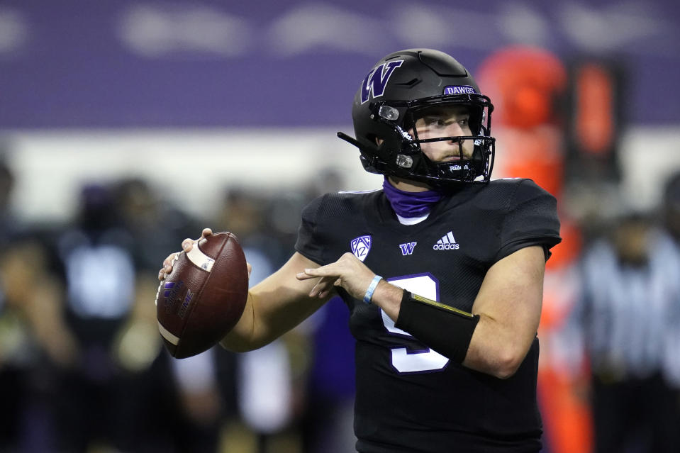 Washington quarterback Dylan Morris drops back to pass against Arizona during the first half of an NCAA college football game Saturday, Nov. 21, 2020, in Seattle. (AP Photo/Elaine Thompson)