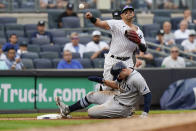 New York Yankees second baseman Rougned Odor, top, throws to first base after forcing out Tampa Bay Rays' Austin Meadows, bottom, during the fourth inning of a baseball game Sunday, Oct. 3, 2021, in New York. Mike Zunino was safe at first on the play. (AP Photo/Frank Franklin II)