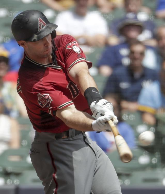 Arizona Diamondbacks' Paul Goldschmidt hits a home run during the second inning of a baseball game against the Milwaukee Brewers Wednesday, May 23, 2018, in Milwaukee. (AP Photo/Morry Gash)