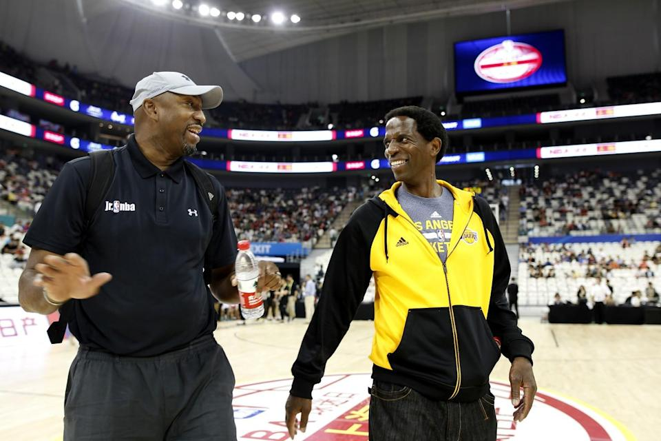 Former NBA stars Vin Baker, left, and A.C. Green walk off the court during a Shanghai fan day in 2016.