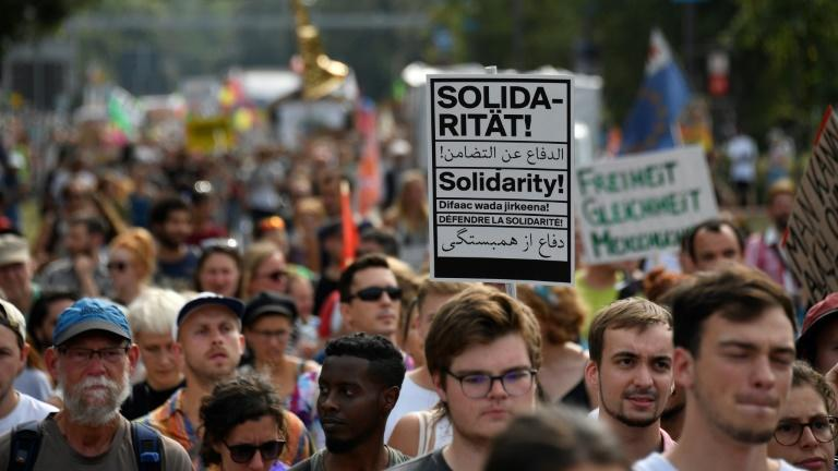 """A large protest in the city of Dresden in Germany's ex-communist east marched in """"solidarity"""" against racism"""