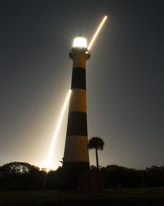 The United Launch Alliance Atlas V 401 rocket carrying NASA's Tracking and Data Relay Satellite-K, TDRS-K, streaks past the lighthouse on Cape Canaveral Air Force Station in Florida after launching from Space Launch Complex 41 at 8:48 p.m. EST