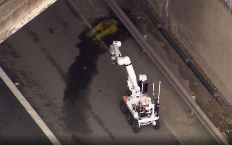 Bomb disposal robot examining a suspicious object found under a bridge on the M1 - PA