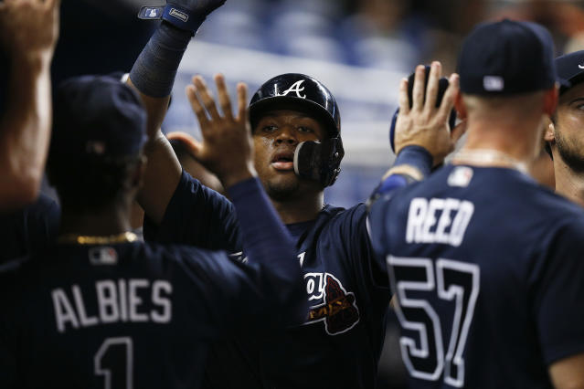 Atlanta Braves left fielder Ronald Acuna Jr. celebrates after scoring during the eighth inning of a baseball game against the Miami Marlins, Monday, July 23, 2018, in Miami. (AP Photo/Brynn Anderson)