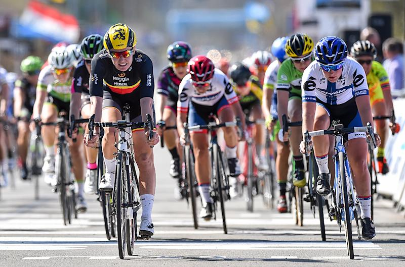 Jolien D'hoore crosses the line ahead of a chase group for 27th place at 2016 Tour of Flanders