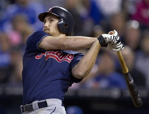 Cleveland Indians' Cord Phelps follows through on a two-run home run during the fifth inning of a baseball game against the Kansas City Royals at Kauffman Stadium in Kansas City, Mo., Saturday, Sept. 22, 2012. (AP Photo/Orlin Wagner)