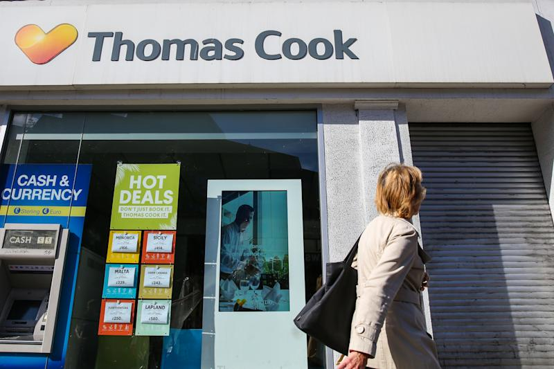 A woman walks past a branch of Thomas Cook in central London. Thomas Cook collapsed under a pile of debt after talks with creditors failed, forcing the British government to charter planes to bring home more than 150,000 of the storied travel providers stranded customers. (Photo by Dinendra Haria / SOPA Images/Sipa USA)
